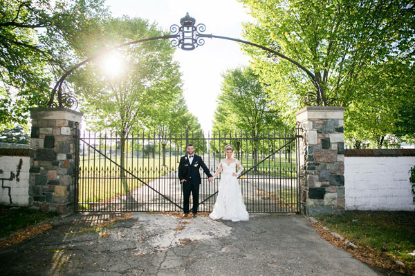 Wedding Couple in front of gates at Packard Proving Grounds entrance