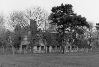 1998 black and white image of a run down Lodge building at the Packard Proving Grounds Historic Site