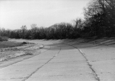 black and white image of the north east curve of the test track taken in 1998 at the Packard Proving Grounds Historic Site