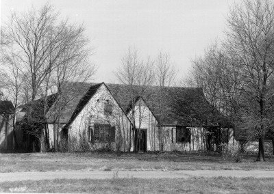 black and white photo of the Repair Garage Building in disrepair taken in 1998