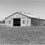 black and white photo taken in 1998 of the aviation hangar located in the center of the test track at the Packard Proving Grounds Historic Site