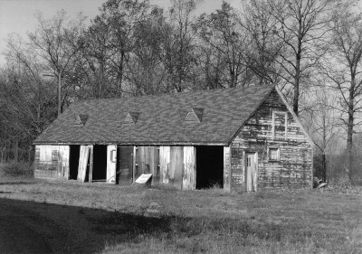 black and white image of the Carriage Garage building in terrible disrepair at the Packard Proving Grounds Historic Site