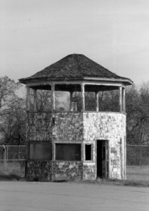 black and white image of the original timing stand in disrepair at the Packard Proving Grounds Historic Site