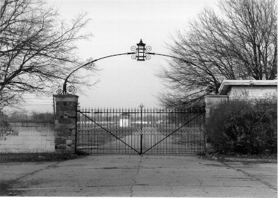 black and white image of the entrance gate at the Packard Proving Grounds Historic Site in 1998