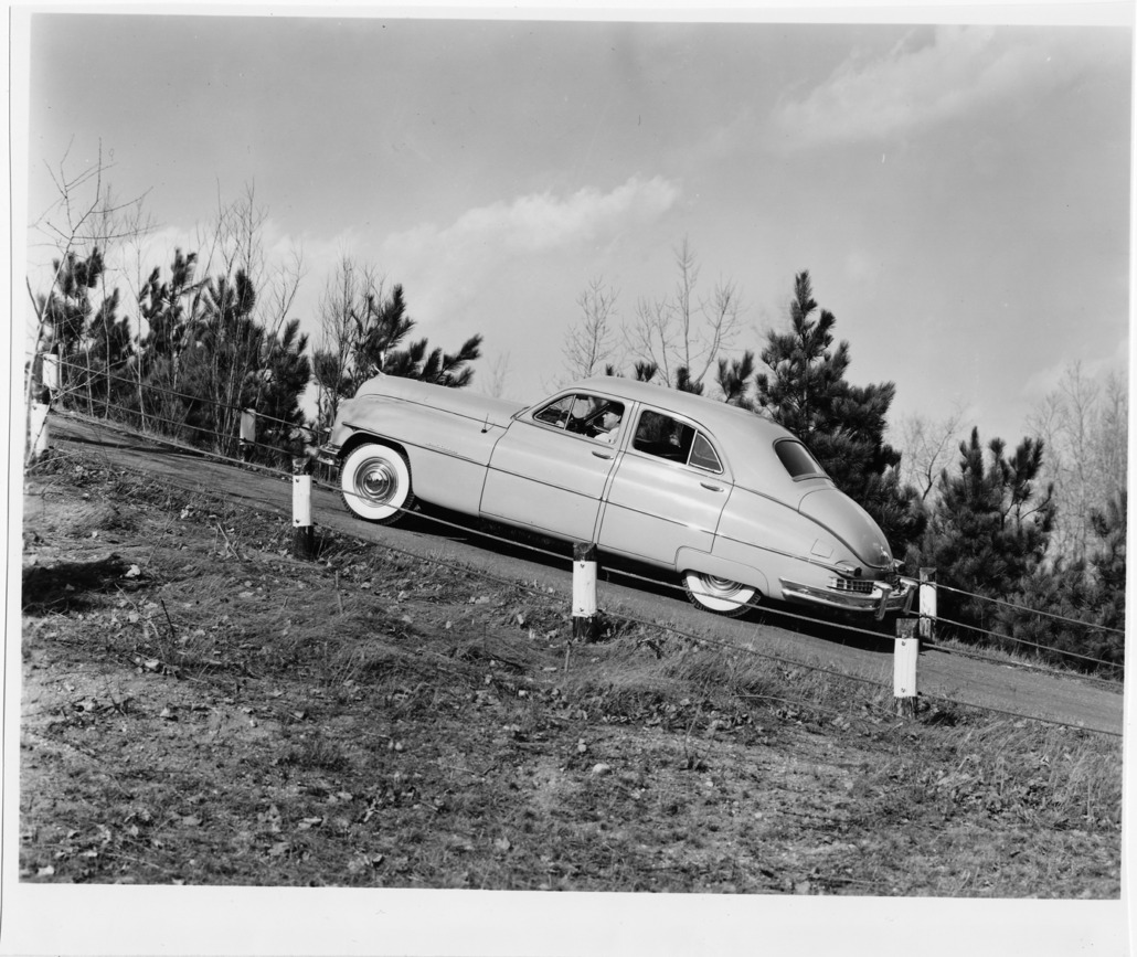 A 1949 Golden Anniversary Packard Custom equipped with Ultramatic drive driving up a steep 38-degree hill at the Packard Proving Grounds