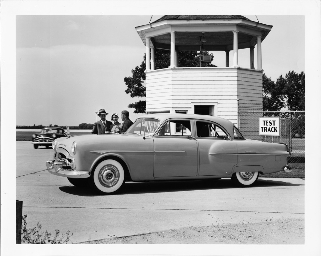 1951 Packard 300 parked at the Proving Grounds timing tower where more than 150,000 miles of grueling tests proved the strength and stamina of the new 1951 Packard with Ultramatic Drive