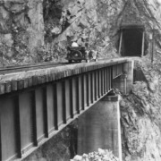 Bement and Evans on a rail trestle in Canadian Rockies